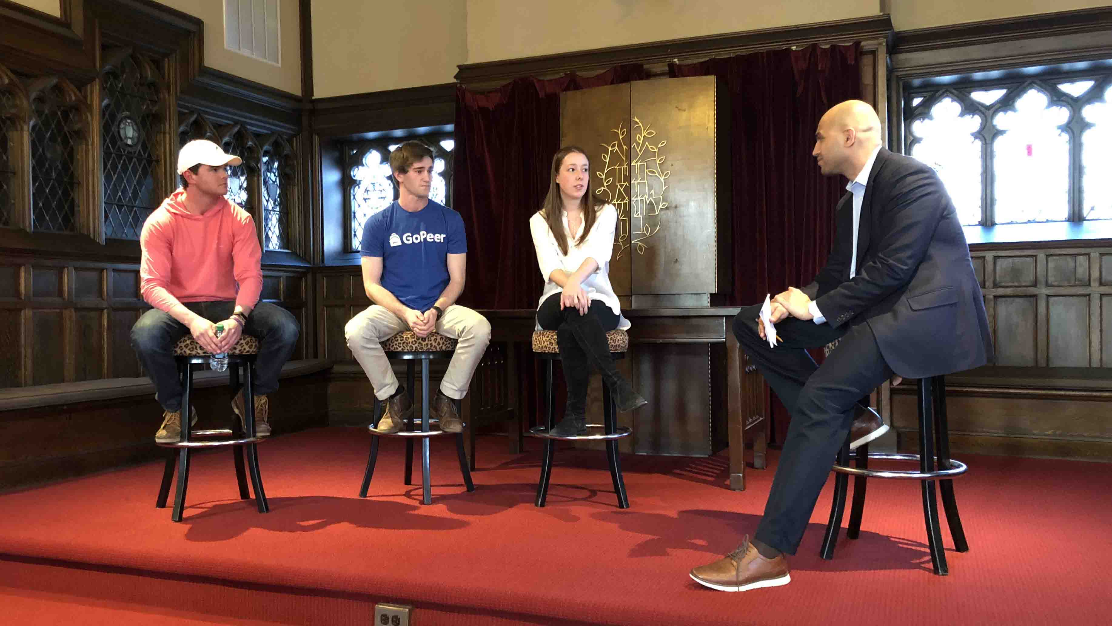 Three student entrepreneurs and Yusuf Dahl, director of the IDEAL Center for Innovation and Entrepreneurship, have a panel discussion.