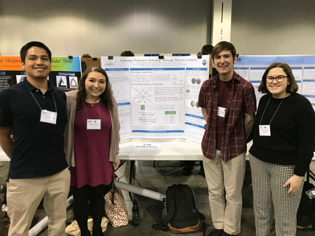 Students stand with their poster at the January Math Meeting in Denver